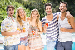 Portrait of friends having juice near pool Royalty Free Stock Photography