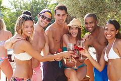 Portrait Of Friends Having Party By Swimming Pool Royalty Free Stock Images