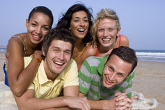 Portrait of friends relaxing at beach royalty free stock photos