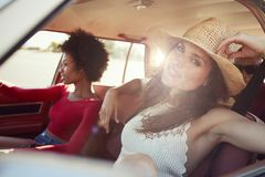 Portrait Of Friends Relaxing In Car During Road Trip Stock Image