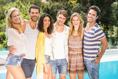 Portrait of friends standing near pool Royalty Free Stock Images