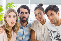 Portrait of friends sticking out tongue. In cafe Royalty Free Stock Image