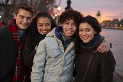 Portrait Of Friends Walking Along South Bank On Visit To London royalty free stock photo