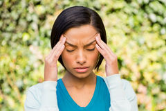 Portrait of frowning brunette with headache Royalty Free Stock Image