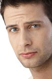 Portrait of frowning guy. Closeup facial portrait of frowning guy looking worried stock image