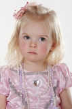Portrait of frowning little girl Royalty Free Stock Photos