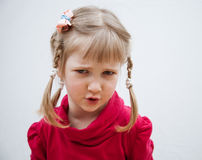 Portrait of a frowning little girl Royalty Free Stock Photo