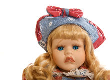 Portrait of a frowning porcelain doll isolated on Stock Photos