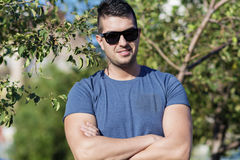 Portrait of frowning young strong man  on the street Royalty Free Stock Image