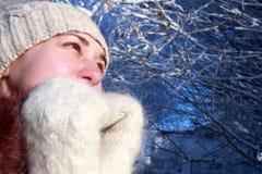 Frozen woman in winter park. Portrait of a frozen woman in winter park Royalty Free Stock Images