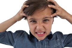 Frustrated boy standing against white background royalty free stock photos