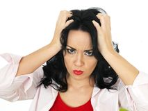 Portrait of a Frustrated Fed Up Young Hispanic Woman Frowning. Portrait of a Frustrated fed up stressed Young Woman with long black curly hair and hispanic or Stock Images