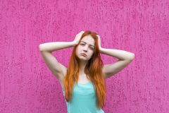 Frustrated red hair girl stock photography