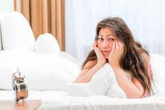 Portrait of a frustrated woman in bed. In the morning Stock Photos