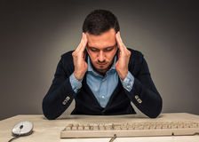 Portrait frustrated young man, hands touch the head Royalty Free Stock Photography
