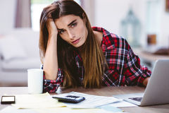 Portrait of frustrated young woman with laptop Stock Photo