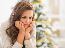 Portrait of frustrated young woman near christmas tree Royalty Free Stock Photography