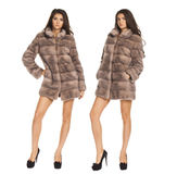 Portrait in full growth on a beautiful woman short mink coat Royalty Free Stock Photos