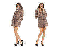 Portrait in full growth on a beautiful woman short mink coat Royalty Free Stock Photography