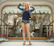 Portrait in full growth the young blonde woman in a blue jacket Royalty Free Stock Image