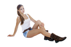 Portrait in full growth the young girl in blue jeans short Royalty Free Stock Images