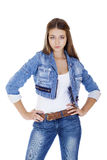 Portrait in full growth the young girl in a jacket and blue jean Stock Photos