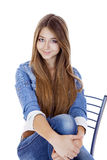 Portrait in full growth the young girl in a jacket and blue jean Royalty Free Stock Photography