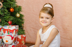 Portrait of a fun five year old girl at the Christmas tree Royalty Free Stock Photo