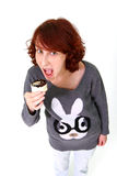 Portrait of a fun woman eating a cake Stock Photos