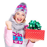 Portrait  of  fun woman with a gift in a winter outerwear. Isolated on white Royalty Free Stock Photography