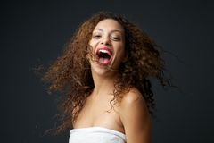 Portrait of a fun young carefree woman laughing Stock Photos