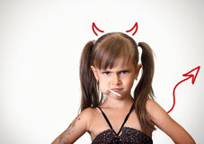 Portrait of funny angry child girl. With candy, behavior concept Stock Image