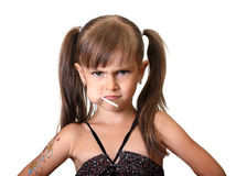 Portrait of funny angry child girl. With candy isolated on white Royalty Free Stock Images