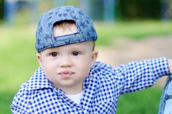 Portrait of funny baby boy outdoors. Portrait of funny baby boy age of 10 months outdoors Royalty Free Stock Photography