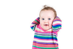Portrait of a funny baby girl in a pink striped dress Royalty Free Stock Photography