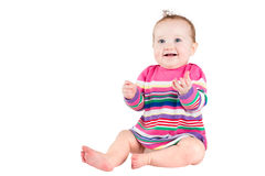 Portrait of a funny baby girl in a pink striped dress Stock Images