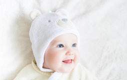 Portrait of a funny baby in a teddy bear hat Royalty Free Stock Image