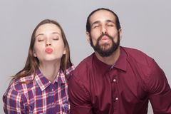 Portrait of funny bearded man and woman in casual style standing stock photo
