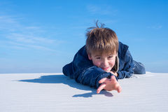 Portrait of a funny boy during travel in a desert Stock Images