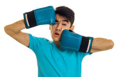 Portrait of funny brunette sports man practicing box in blue gloves isolated on white background Stock Photography