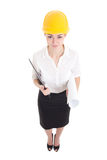Portrait of funny business woman architect in yellow builder hel Royalty Free Stock Photo