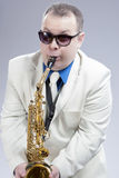 Portrait of Funny Caucasian Saxophone Player in Sunglasses Stock Photography