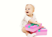 Portrait of funny child sitting with boxes Stock Photos