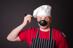 Portrait of the funny cook with a ladle in his hand Royalty Free Stock Photography