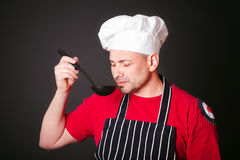 Portrait of the funny cook with a ladle in his hand Royalty Free Stock Image