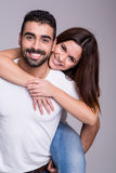 Portrait of a funny couple. Portrait of a funny love couple hugging each other stock image