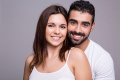 Portrait of a funny couple. Portrait of a funny love couple hugging each other stock photography