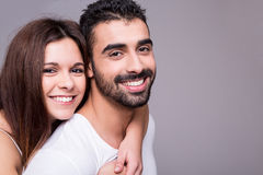 Portrait of a funny couple. Portrait of a funny love couple hugging each other stock images