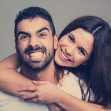 Portrait of a funny couple. Portrait of a funny love couple hugging each other royalty free stock photo