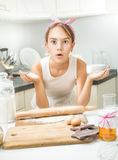 Portrait of funny cute girl making dough on kitchen Stock Photo